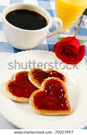 A single red rose graces a romantic breakfast treat with heart-shaped toast