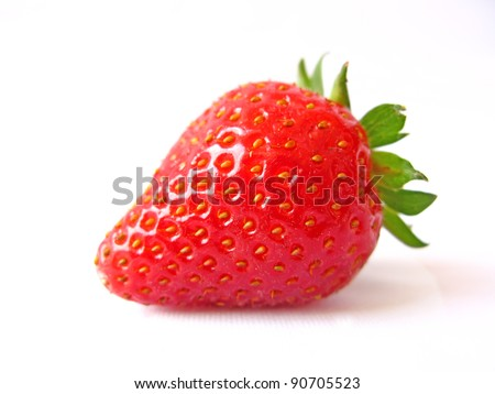 A single red strawberry isolated in white