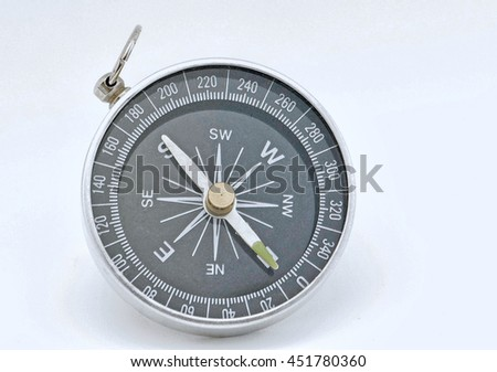 a single round compass on a white surface Foto stock ©