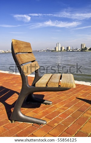 A single seat on the river bank in Rotterdam, Holland