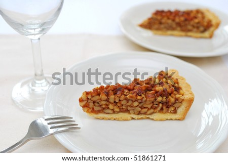 A single slice of hazel nut tart on white plate. For concepts such as food and beverage, diet and nutrition, and healthy eating.