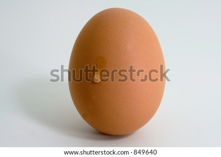 A single tear flowing down a brown egg