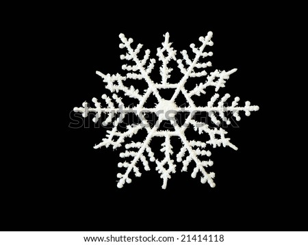 A single white snowflake with glitter on a black background.
