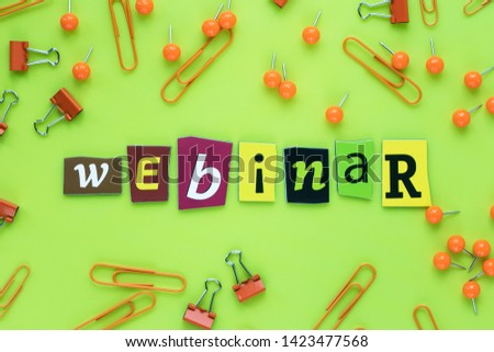 A single word - webinar of cut letters on yellow green background. Headline, caption, heading from colored letters. A word writing text - webinar. Banner with the inscription of advertisement, ad. #1423477568
