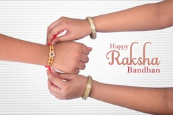 A sister is binding rakhi on her brother hand on the festival of raksha Bandhan, Rakshabandhan
