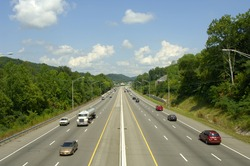 A six-lane interstate highway with divider.  Lots of travelers on a late summer day. US Highway 640 in Knoxville, Tennessee, uSA.