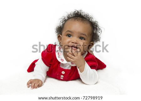 A six month old baby girl staring with amusement