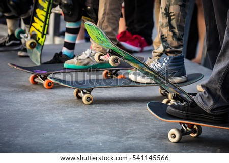 A skateboarder in action at Venice Beach Skate Park in Los Angeles, California, USA - Shutterstock ID 541145566
