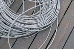 A skein of metal rope twisted  wire. Dark wooden background.