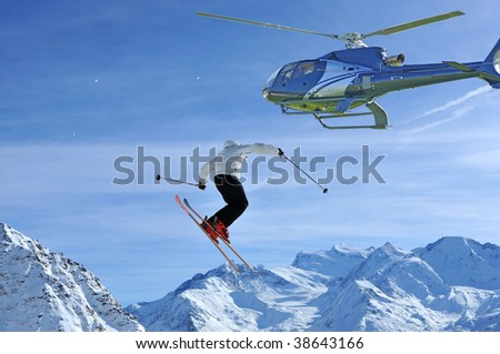a skier executing a very high jump being observed from a helicopter