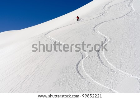 a skier makes his tracks in the deep powder snow Foto stock ©