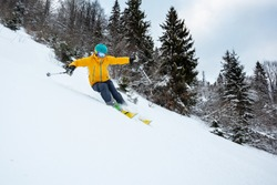 A skiier is riding down the hill. Freeriding in Carpathian mountains.