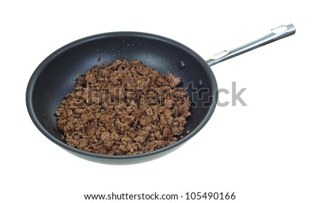 A skillet with a large portion of cooked ground beef on a white background.