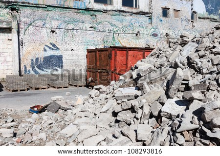 A skip full of rubble outside a construction site