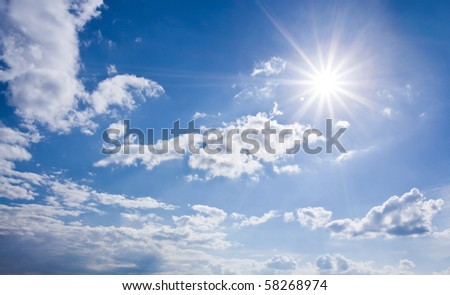 A sky panorama with the sun, blue sky and clouds
