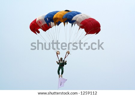 A skydiver controlling his parachute.