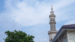 a skyscraper tower of the mosque with the dusk sky view. traditionally, the tower was for someone to call to prayer so can be heard from all directions.