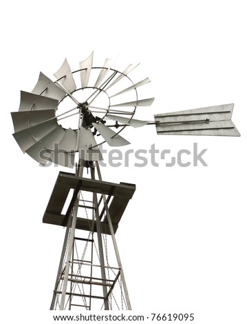 A skyview angle of an old windmill and tower used by early homesteaders to pump water from a well on an isolated white background.