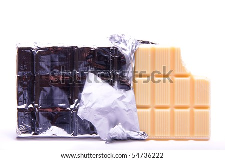 A slab of white creamy chocolate in a silver foil rapper on a white background.