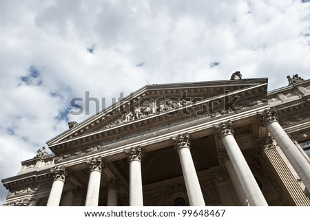 A slanted shot of the front of the Brussels Stock Exchange La Bourse.
