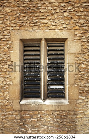 A slatted window in sandstone block setting from Cambridge UK
