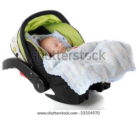 A sleeping baby in an infantm carrier/car seat.  Isolated on white.