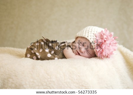 A sleeping three week old baby girl with soft focus