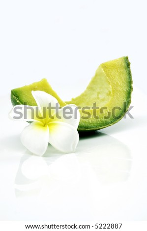 A slice of avocado isolated with tropical flower