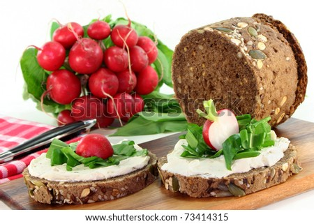 a slice of bread topped with fresh cheese and fresh garlic