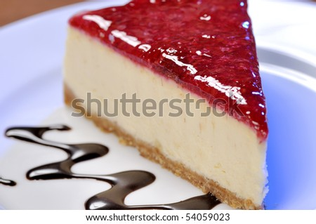 A slice of cherry cheesecake.