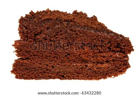A slice of chocolate cake with chocolate cream isolated on white background