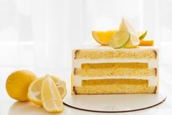 A slice of citrus cake with lemon and orange. half a lemon cake. cutaway lemon cake. sponge cake