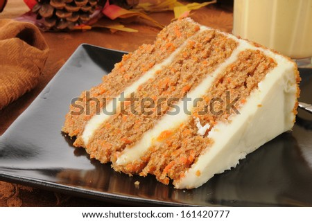 A slice of gourmet carrot cake with eggnog on a holiday table