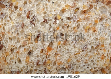 A slice of sliced brown bread, texture closeup
