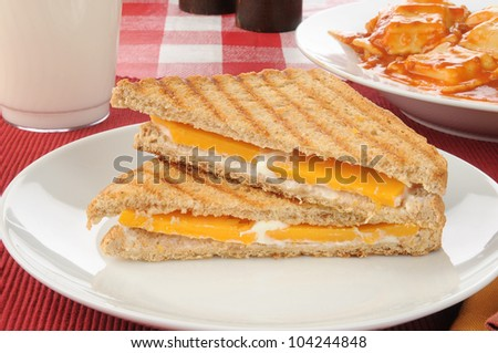A sliced grilled cheese sandwich with ravioli