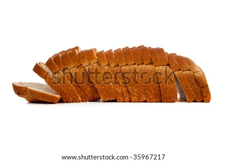 A sliced loaf of wheat bread on a white background with copy space