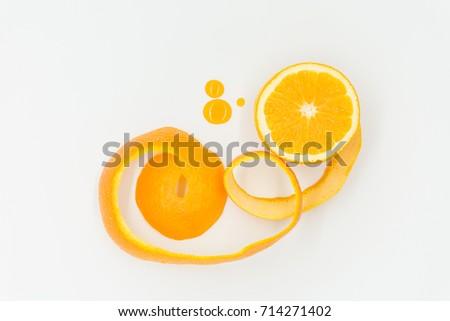 A sliced of orange with orange peel  and orange juice drop with whiten background #714271402
