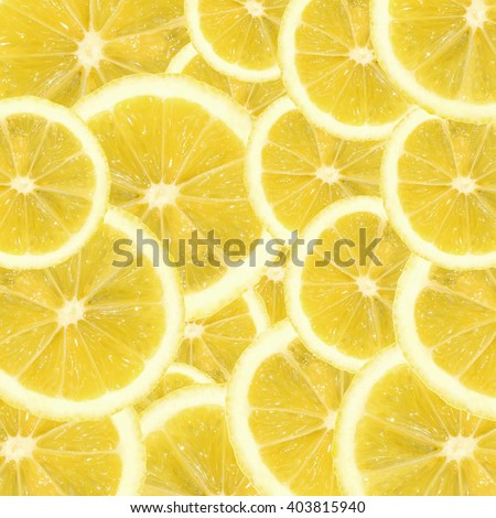 A slices of fresh yellow lemon texture background pattern. Lemon pieces in different sizes background. Texture formed by lemons.