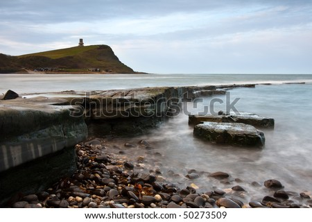 A slow shutter landscape shot of the tide coming in over the rocks at Kimmeridge Bay in Dorset, UK.