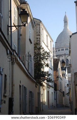 A small alley in Montmartre with the church of Sacre Coeur in background, Paris, France