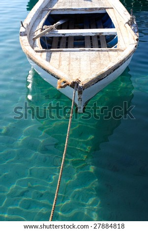 A small anchored fishing boat near the beach. The Photo was shot at Hurghada, Egypt, early in the morning.