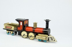 A small antique tinplate floor locomotive by Hess of Germany on a plain white background.