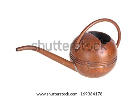 A small antique watering can made of copper metal isolated against a white background