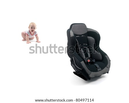 A small baby girl and a car seat