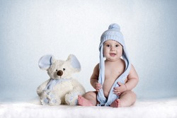 a small baby with his favorite teddy