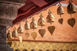 a small bell hanging under the temple roof at the marble temple