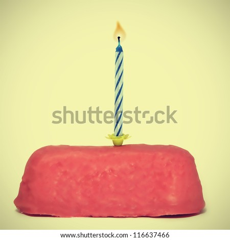 a small birthday cake with candle with a retro effect
