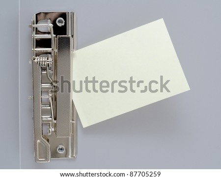 a small blank sheet of note paper in a clip file - stock photo