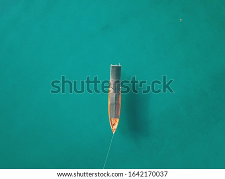 A small boat at Koh Roh Sanloem Island, Sihanoukville, Cambodia. Minimalism concept background. Stock fotó ©