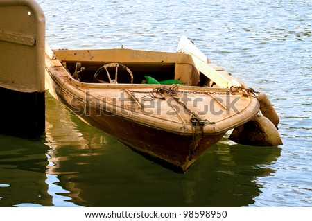 a small boat moored in water
